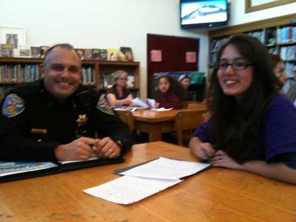 Slick student-journalist interviewing Captain Bob Moser of the SFPD